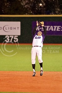 (Photo by Jed Barker | Collegian) Junior infielder Ross Kivet jumps to catch a fly ball for the third out during the top of the 4th inning against the Wichita State Shockers at Tointon Family Stadium on April 9, 2013. K-state won the game 7-6 and also won Tuesday's 9 (April 16, 2013) game 4-1, good for a season sweep.
