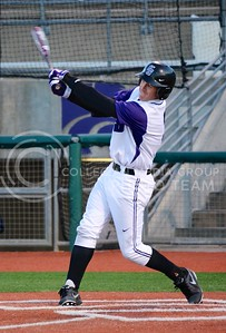 (Parker Robb | Collegian)  K-State batter Austin Fisher smacks the ball into the outfield during the Wildcats' game against Northern Colorado March 12, 2013 at Tointon Family Stadium.