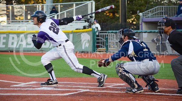 (Parker Robb | Collegian)  K-State batter RJ Santigate hits a pop fly into the outfield during the Wildcats' game against Northern Colorado March 12, 2013 at Tointon Family Stadium.