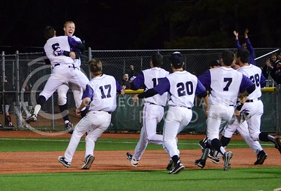 K-State players celebrate midfield after batter Austin Fisher batted Jared King in to score, giving the Wildcats a 6-5 walk-off victory over the Texas Tech Red Raiders April 5, 2013, at Tointon Family Stadium.