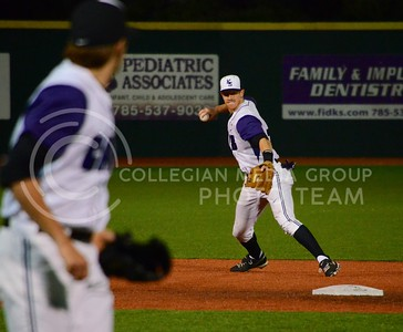 (Photo by Parker Robb | Collegian)  K-State short stop Austin Fisher passes the ball to first base for an out during the Wildcats' first game of the series against Texas Tech April 5, 2013, at Tointon Family Stadium. The Wildcats defeated the Red Raiders in a walk-off victory, winning 6-5.