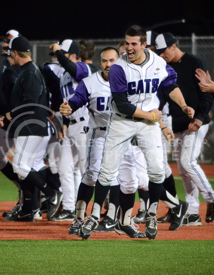 (Photo by Parker Robb | Collegian)<br /> <br /> K-State left fielder Ross Kivett celebrates with a fist pump after batter Austin Fisher batted Jared King in to score, giving the Wildcats a 6-5 walk-off victory over the Texas Tech Red Raiders April 5, 2013, at Tointon Family Stadium.