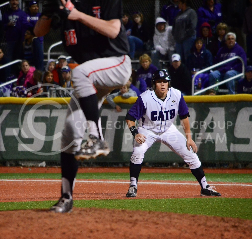 (Photo by Parker Robb | Collegian)<br /> <br /> K-State batter Shane Conlon takes a few steps from first base, preparing to run, as the Texas Tech pitcher winds up, during the ninth inning of the Wildcats' first game of the series against Texas Tech April 5, 2013, at Tointon Family Stadium. The Wildcats defeated the Red Raiders in a walk-off victory, winning 6-5.