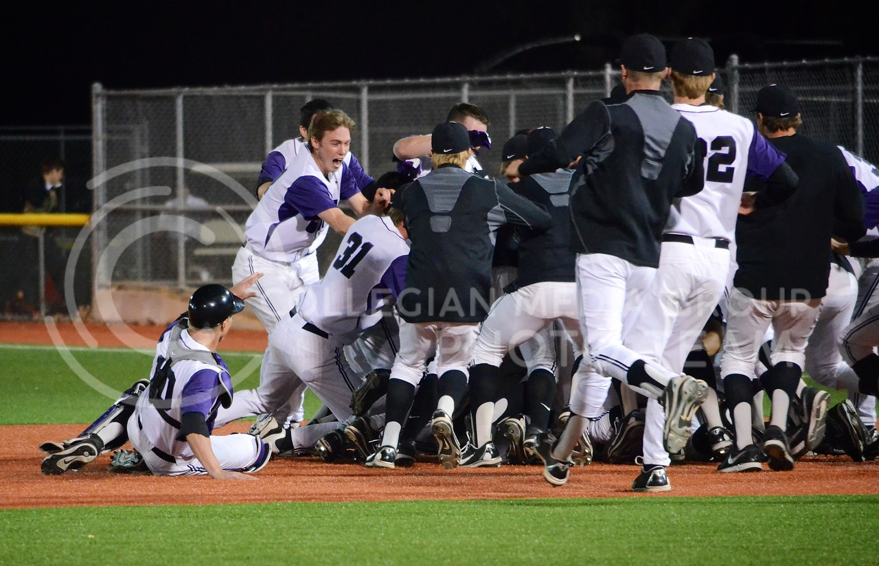 (Photo by Parker Robb | Collegian)<br /> <br /> K-State players celebrate midfield after batter Austin Fisher batted Jared King in to score, giving the Wildcats a 6-5 walk-off victory over the Texas Tech Red Raiders April 5, 2013, at Tointon Family Stadium.