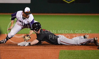 (Photo by Parker Robb | Collegian)  K-State second baseman Ross Kivett tags the base as a Texas Tech player slides in during the ninth inning of the Wildcats' first game of the series against Texas Tech April 5, 2013, at Tointon Family Stadium. The Texas Tech player was declared safe. The Wildcats defeated the Red Raiders in a walk-off victory, winning 6-5.