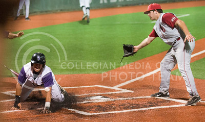(Photo by Emily DeShazer   Collegian) Tanner Witt slides in to score the go ahead run after a wild pitch against Oklahoma on May 17, 2013 at Tointon Family Stadium.