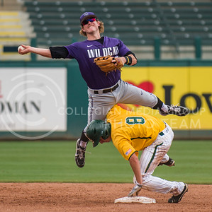 K-State short stop Lance Miles leaps over Baylor second baseman Lawton Langford to throw to first during the 13-9 win over the Bears Friday at Chickasaw Bricktown Ballpark during the Big 12 Championship.  The Wildcats scored five runs in the ninth inning to take and ensure the win that coach Hill hopes will give K-State the chance to host a regional for the NCAA tournament. (Photo by Emily DeShazer | Collegian)
