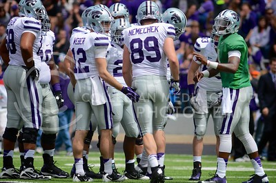 (Photo by Parker Robb | Collegian)  Sophomore quarterback Daniel Sams (far right) goes over the next play with his team during the annual Purple-White Spring Game April 27, 2013, at Bill Snyder Family Stadium.