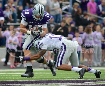 (Photo by Parker Robb | Collegian)  Junior defensive back Travis Green goes for the legs as he tries to tackle tight end Andrew McDonald during the annual Purple-White Spring Game April 27, 2013, at Bill Snyder Family Stadium.
