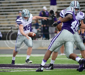 (Photo by Parker Robb | Collegian)  Junior punter Ethan Hammes winds up for a kick during the first quarter of the annual Purple-White Spring Game Saturday at Bill Snyder Family Stadium.