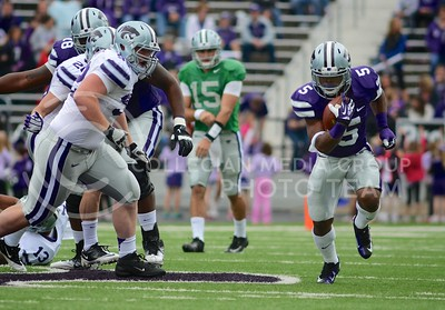 (Photo by Parker Robb | Collegian)  Senior running back Robert Rose evades freshman defensive lineman Matt Seiwert, picking up some yards in the process, during the annual Purple-White Spring Game April 27, 2013, at Bill Snyder Family Stadium.