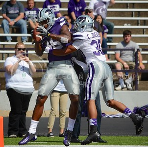 (Photo by Parker Robb | Collegian)  Senior wide receiver Torell Miller hauls in a catch in the end zone while being tackled by freshman defensive back Corey Jackson during the annual Purple-White Spring Game April 27, 2013, at Bill Snyder Family Stadium.