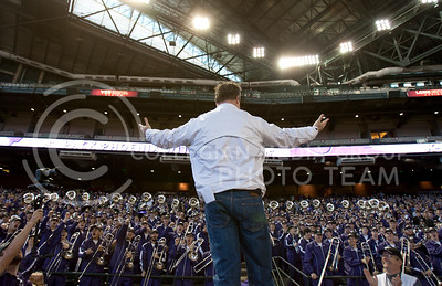 Conducting the KSU Marching Band, Eric Stonestreet, alumnus and Modern Family cast member, leads songs at the pep rally in Chase Stadium Wednesday January 1, 2013, in Phoenix, Ariz.  (Photo by Evert Nelson / Collegian)