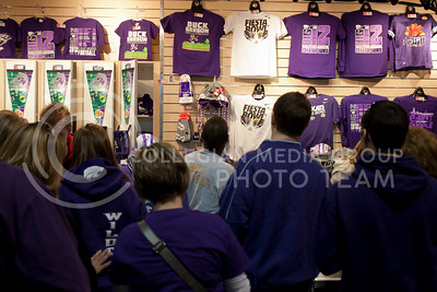 Fans line up to buy Kansas State apparel and gear at Chase Stadium before the pep rally Wednesday, January 2, 2013.  (Photo by Evert Nelson / Collegian)