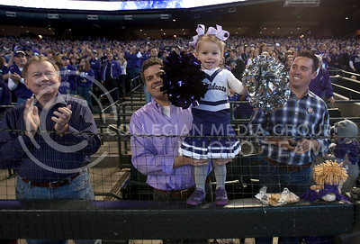 A family cheers on the Wildcats during the pep rally Wednesday January 2, 2013 at Chase Stadium in Phoenix Arizona. The Cats play in the Fiesta Bowl Tomorrow January 3, 2013 against Oregan University.  (Photo by Evert Nelson / Collegian)