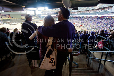 A couple hugs before the pep rally for Kansas State begins at Chase Stadium at Phoenix Arizona Wednesday January 2, 2013.  (Photo by Evert Nelson / Collegian)