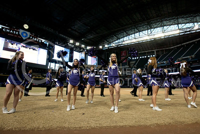 Kansas State cheerleaders cheer on the Cats football team during a pep rally at Chase Stadium in Pheonix Arizona Wednesday January 3, 2013.  (Photo by Evert Nelson / Collegian)