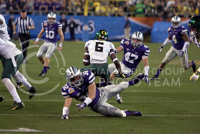 Oregon's De'Anthony Thomas, sophomore running back, makes his way through Wildcat defenders during a play at the Fiesta Bowl in Phoenix, Ariz. January 3, 2013.  (Photo by Evert Nelson / Collegian)