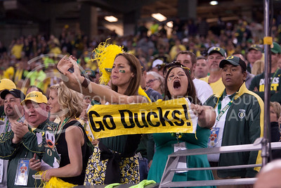 Oregon fans show their spirit during the Fiesta Bowl in Pheonix Ariz. January 3, 2013.  (Photo by Evert Nelson / Collegian)