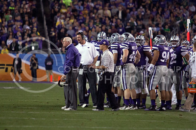 Coach Bill Snyder stands in front of his team on the field after a play against Oregon University Jan. 3, 2013 for the Fiesta Bowl in Pheonix Ariz.  (Photo by Evert Nelson / Collegian)