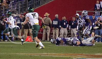 Oregon's Reggie Daniels, freshman defensive back, runs the ball down field while Wildcats fall and trail behind during the Fiesta Bowl in Pheonix Ariz. January 3, 2013.  (Photo by Evert Nelson / Collegian)