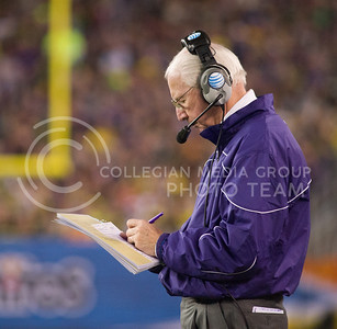 (Photo by Emily DeShazer | Collegian) Bill Snyder writes a note during the Fiesta Bowl January 3, 2013