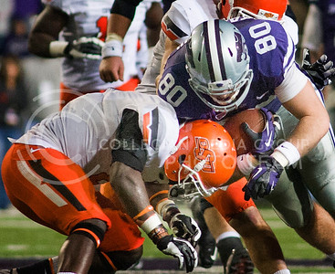 (Photo by Emily DeShazer | Collegian)  Senior tight end Travis Tannahill is hit by an Oklahoma State player on November 3, 2012 at Bill Snyder Family Stadium.