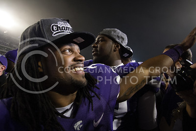 #33, John Hubert, junior running back, waves to fans after the game against Texas Satuday at Bill Snyder Family Stadium. After the Cats 42-24 win, fans rushed the field and watched as the Big XII Champion trophy was award to the Cats.  (Photo by Evert Nelson / Collegian)