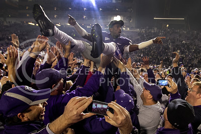 #3 Allen Chapman, senior defensive back, crowd surfs over fans at Bill Snyder Family Stadium Saturday night after the Cat's victory against Texas. The Wildcats won 42-24.  (Photo by Evert Nelson / Collegian)