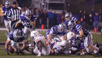 Drew Liddle, sophomore offensive lineman, recovers a fumble from Texas during their game Saturday night at Bill Snyder Family Stadium. The Cats won 42-24.  (Photo by Evert Nelson / Collegian)