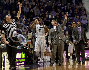 Confusion reigns in the closing seconds of the first half of the Wildcats' 83-57 victory over the visiting Texas Longhorns on January 30th in Bramlage Coliseum. Players and coaches reacted to the game clock reaching zero, when it shouldn't have been running at all due to a necessary second free throw by Texas center Cameron Ridley. [Jacob Dean Wilson]