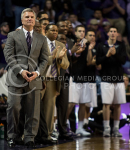 Head Coach Bruce Weber and the rest of the Wildcat bench cheer on their team in the closing minutes of their 83-57 victory over the visiting Texas Longhorns on Wednesday night in Bramlage Coliseum. [Jacob Dean Wilson]