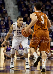 Sophomore guard Angel Rodriguez defends University of Texas guard Javan Felix during the Wildcats' 83-57 victory over the visiting Longhorns on January 30th in Bramlage Coliseum. [Jacob Dean Wilson]