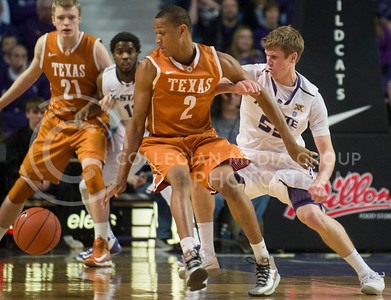 (Photo by Emily DeShazer | Collegian) Will Spradling looks for the ball after a Texas player lost it at Bramlage Coliseum on January 30, 2013.