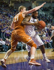 (Photo by Emily DeShazer | Collegian) Thomas Gipson shifts around a Texas player  at Bramlage Coliseum on January 30, 2013.