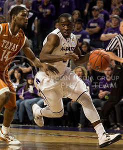 Senior guard Martavious Irving drives past University of Texas sophomore guard Julien Lewis during the Wildcats' 83-57 victory over the visiting Longhorns on January 30th in Bramlage Coliseum. [Jacob Dean Wilson]