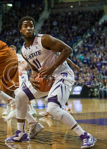 (Photo by Emily DeShazer | Collegian) Nino Williams looks behind him for a path to the basket at Bramlage Coliseum on January 30, 2013.