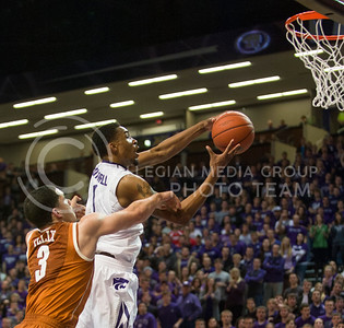 (Photo by Emily DeShazer | Collegian) Shane Southwell goes up for a basket as he's fouled by a Texas player at Bramlage Coliseum on January 30, 2013.