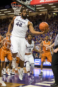 (Photo by Emily DeShazer | Collegian) Thomas Gipson saves the ball just before it goes out of bounds at Bramlage Coliseum on January 30, 2013.
