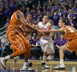 (Photo by Emily DeShazer | Collegian) Angel Rodriguez goes up for a shot as three Texas players try to strip him of the ball at Bramlage Coliseum on January 30, 2013.