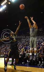 (Photo by Parker Robb | Collegian)  K-State sophomore guard Angel Rodriguez shoots one of the Wildcats' many threes during the Wildcats' game against Bob Huggin's West Virginia Mountaineers February 18 at Bramlage Coliseum. The Wildcats beat the Mounaineers 71-61 amid a game that included 49 personal fouls and 55 free throws.