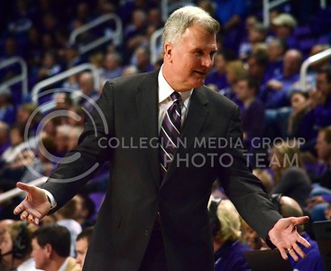 (Photo by Parker Robb | Collegian)  K-State Head Men's Basketball Coach Bruce Weber  gestures toward his team during the Wildcats' game against Bob Huggin's West Virginia Mountaineers February 18 at Bramlage Coliseum. The Wildcats beat the Mounaineers 71-61 amid a game that included 49 personal fouls and 55 free throws.