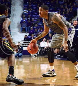 (Photo by Parker Robb | Collegian)  K-State senior forward Rodney McGruder tries to find a way past a West Virginia defender during the Wildcats' game against Bob Huggin's West Virginia Mountaineers February 18 at Bramlage Coliseum. The Wildcats beat the Mounaineers 71-61 amid a game that included 49 personal fouls and 55 free throws.