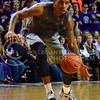 (Photo by Parker Robb | Collegian)<br /> <br /> K-State senior forward Rodney McGruder dribbles the ball down the court during the Wildcats' game against Bob Huggin's West Virginia Mountaineers February 18 at Bramlage Coliseum. The Wildcats beat the Mounaineers 71-61 amid a game that included 49 personal fouls and 55 free throws.