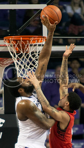 Sophomore forward Thomas Gipson blocks the shot of opposing Texas Tech freshman guard Josh Gray during the Wildcats' 75-55 win over the visiting Red Raiders on February 25th in Bramlage Coliseum. Gipson scored a game high 20 points in the victory. [Jacob Dean Wilson | Collegian]