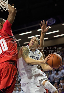 Sophomore guard Angel Rodriguez fights for a shot over Texas Tech junior forward Jaye Crockett during the Wildcats' 75-55 win over the visiting Red Raiders on February 25th in Bramlage Coliseum. [Jacob Dean Wilson | Collegian]