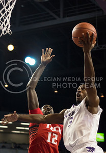 Senior guard Martavious Irving goes past Texas Tech junior forward Kader Tapsoba for a shot during the Wildcats' 75-55 win over the visiting Red Raiders on February 25th in Bramlage Coliseum. [Jacob Dean Wilson | Collegian]