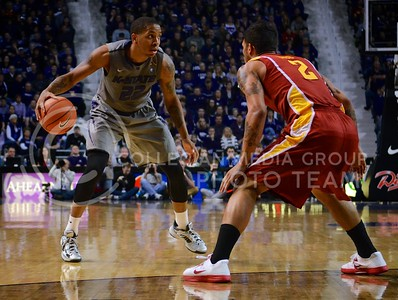 (Photo by Parker Robb | Collegian)  K-State forward Rodney McGruder attempts to dribble around an Iowa State defender February 9, 2013 at Bramlage Coliseum. The Wildcats avenged their earlier loss to the Cyclones in Ames with a 79-70 victory, and now remain the sole team in possession of first place in the Big XII.