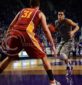 (Photo by Parker Robb | Collegian)  K-State guard Angel Rodriquez attempts to dribble past an Iowa State defender during the Wildcats' game against Iowa State February 9, 2013 at Bramlage Coliseum. The Wildcats avenged their earlier loss to the Cyclones in Ames with a 79-70 victory, and now remain the sole team in possession of first place in the Big XII.