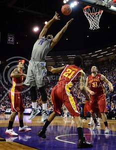 (Photo by Parker Robb | Collegian)  K-State forward Nino Williams reaches for a rebound against Iowa State February 9, 2013 at Bramlage Coliseum. The Wildcats avenged their earlier loss to the Cyclones in Ames with a 79-70 victory, and now remain the sole team in possession of first place in the Big XII.